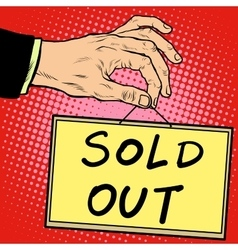 Hand holding a sign sold out vector