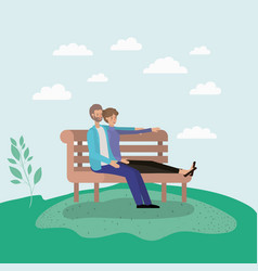 young couple lovers sitting on park chair vector image