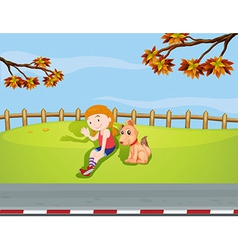 A girl with a dog inside the fence vector image