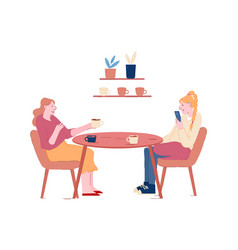 couple girl friends sitting at table drinking vector image