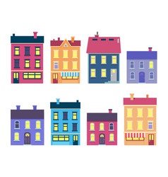 Collection of colourful xmas buildings on white vector