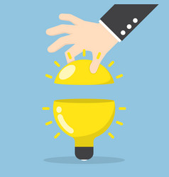 businessman hand open the light bulb vector image