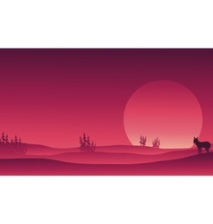 Silhouette of wolf in hills scenery vector image vector image