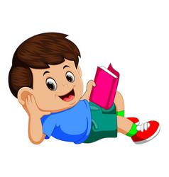 boy reading book with enjoy vector image