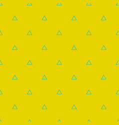 tile pattern with green triangles on yellow vector image