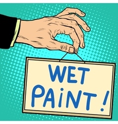 Hand holding a sign wet paint vector