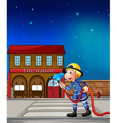 A fireman near a fire station vector image vector image