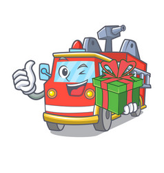 With gift fire truck mascot cartoon vector