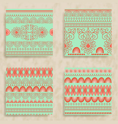 4 tribal seamless patterns vector image