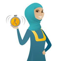 Young muslim business woman holding alarm clock vector