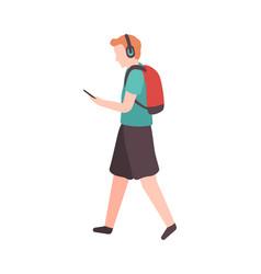 young man walks down street vector image