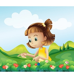 A little girl at the strawberry farm vector