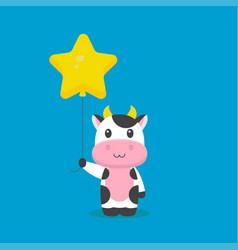 Cute cow holding balloon free vector