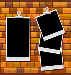Picture frames on brick wall vector