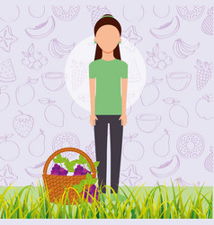 Woman with basket full grapes in the grass vector