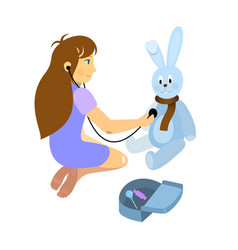 little girl playing a doctor with plush rabbit toy vector image