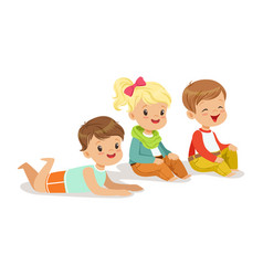 sweet little kids sitting and lying on the floor vector image