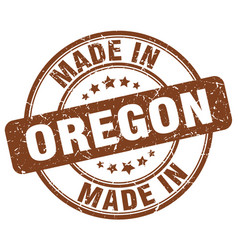 made in oregon brown grunge round stamp vector image vector image