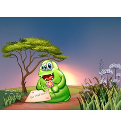 A monster holding a card and a flower vector image