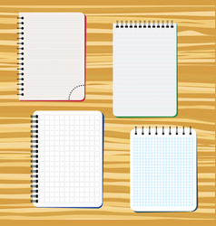 four notebooks on a wooden table vector image