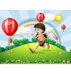 A girl running at the hilltop vector