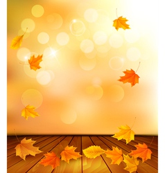 Background with wooden floor and autumn leaves vector image