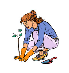 woman working in garden planting a seedling vector image