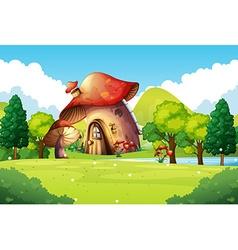 Mushroom house in the field vector