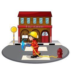 A fireman holding a hose vector image