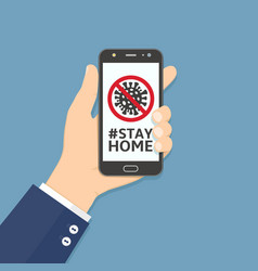 Hand holding smartphone with stay home hashtag vector