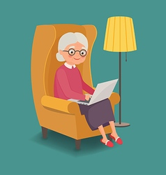 Elderly woman sitting in a chair with a laptop vector image