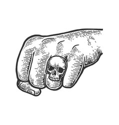 Fist with skull ring vector