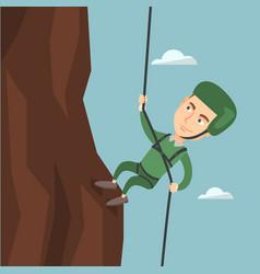 Man climbing a mountain with a rope vector