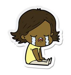 Sticker of a cartoon girl crying sat on floor vector
