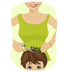 little boy getting a haircut at the barber shop vector image vector image