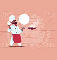 African american chef cook holding frying pan vector