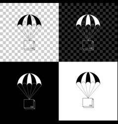 box flying on parachute icon isolated on black vector image
