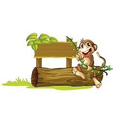 A monkey sitting with a wooden signboard vector image vector image