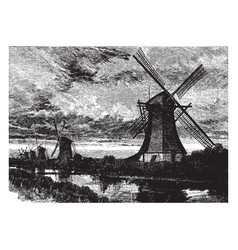 Windmills along a canal vintage vector