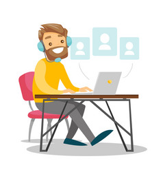 a white man in headset working at the office desk vector image