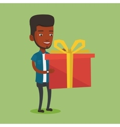 Joyful african-american man holding box with gift vector
