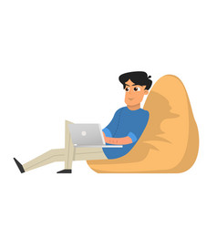 young man working with laptop sitting in armchair vector image