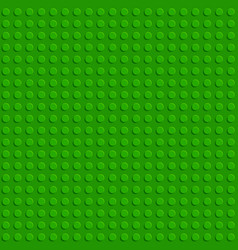Green plastic construction block plate seamless vector
