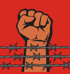 raised hand with clenched fist behind barbed wire vector image
