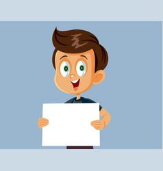 Cheerful little boy holding blank advertising vector