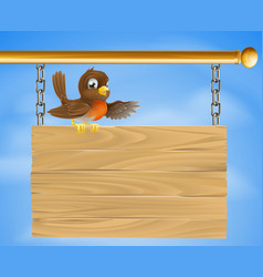 robin sitting on old sign vector image