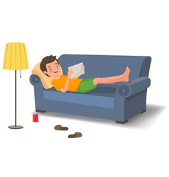 Young man lying on the couch with a tablet vector