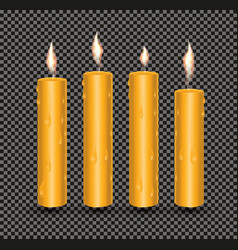 Realistic orange glowing candles with melted wax vector