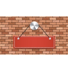 Red label is holding on brick wall vector image