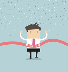 Businessman running success at the finish line vector